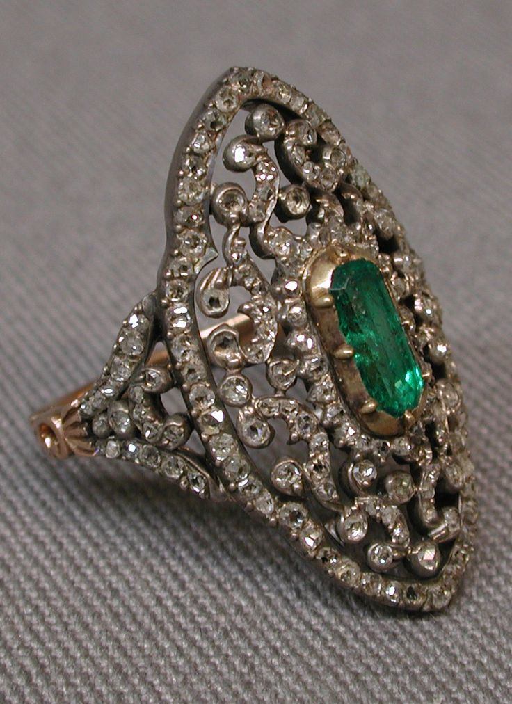 An antique gold, silver, emerald and diamond ring, French, 1838–47. With a…