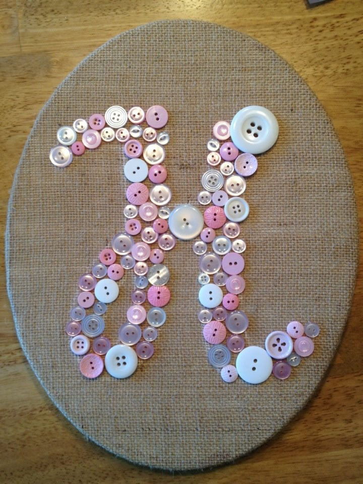 """Button monogram -- DIY-- """"H"""" is for Holly -- pink buttons on burlap-covered canvas I made for my niece. Just need canvas, hot glue, fabric and a lot of buttons. I used a stencil for the H and outlined it with chalk."""