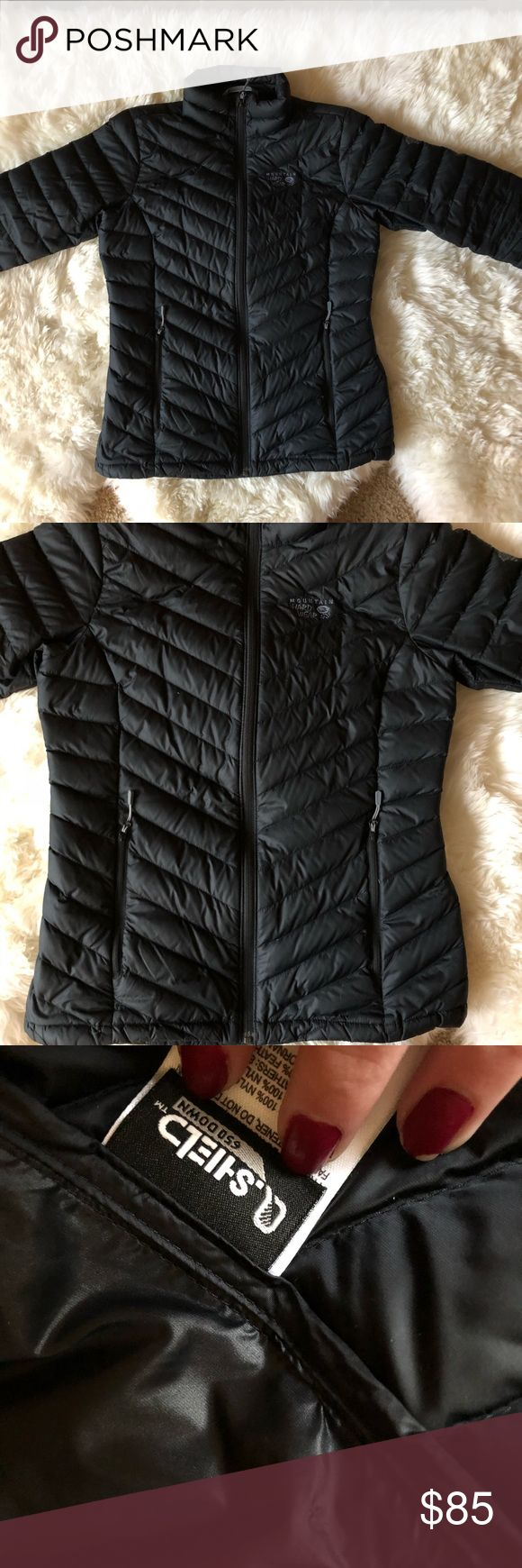 Women's down Mountain Hardwear jacket Very lightweight, yet also very warm. I believe that this is the micro ratio jacket. I have had it almost a year (i think i got it late feb of 2017), so it has really only been worn for one winter, but it has no wear and tear, no rips. only thing is that there a a couple spots where threads were pulled, but they can be cut or fixed, and it doesn't affect the coat at all. It is 650 down fill (80% duck down, 20% feathers) the shell and lining is nylon…