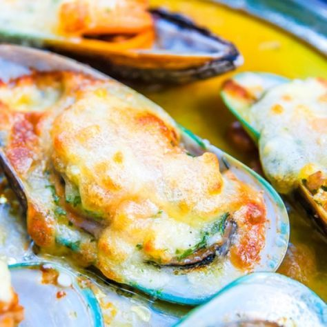 A Delicious recipe for mussels baked in a spicy garlic butter. Serve with bread to soak up the yummy extra juice.. Baked Mussels in Spicy Garlic Butter Recipe from Grandmothers Kitchen.