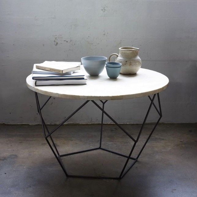 Thin steel rods on this coffee table are bent every which way to mimic origami.