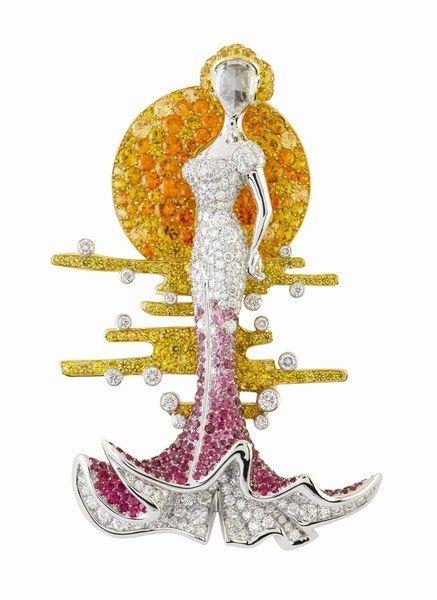 Clip Cantatrice, spinelles rouges, saphirs jaunes, grenats mandarins et diamants. Collection Bal Proust- Bals de Légende de Van Cleef & Arpels