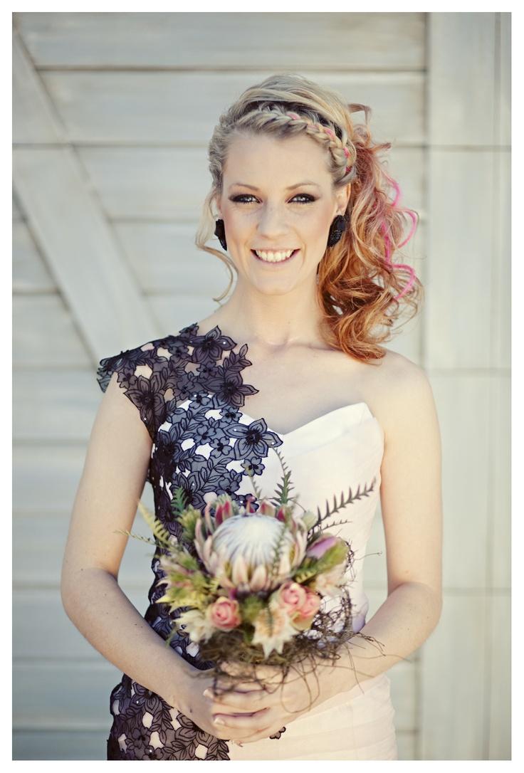 Wedding portrait. Protea bouquet.
