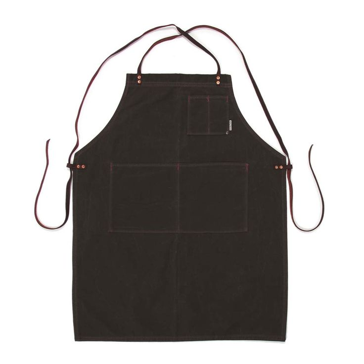 The Shop Apron from Iron & Resin is a manly heavy duty apron for working in your shed, woodworking, welding, bodging, grinding or flipping burgers on the barbeque! The Shop Apron is made from heavy duty Martexin waxed cotton canvas with leather cross over shoulder straps. There are front pockets for easy access and is hand made and built to last.