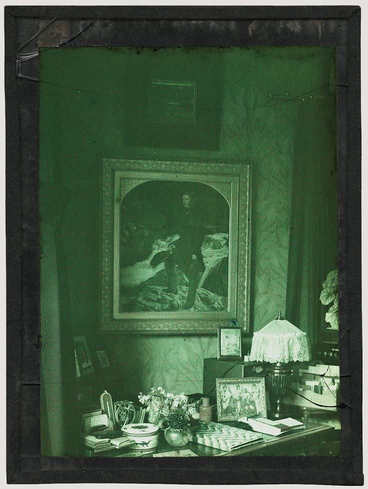 Courtesy of the Museum of the History of Science, Oxford  Sarah Angelina Acland; Millais's portrait of Ruskin hanging above Miss Acland's writing desk in Clevedon House, Park Town, Oxford; Autochrome, 1913-17