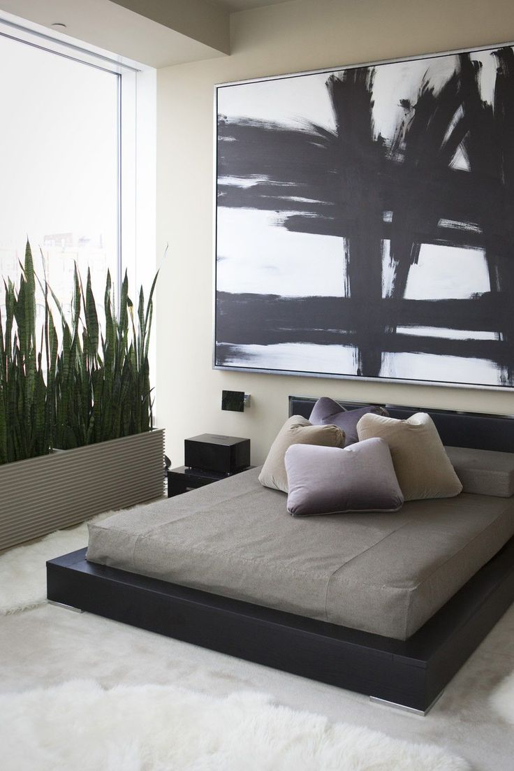 30 Bedrooms So Dreamy, You Won't NEED A Vacation #refinery29  http://www.refinery29.com/pinterest-worthy-bedrooms#slide-9  A low-lying bed frame lets bold, graphic artwork take center stage in this modern, light-filled bedroom....