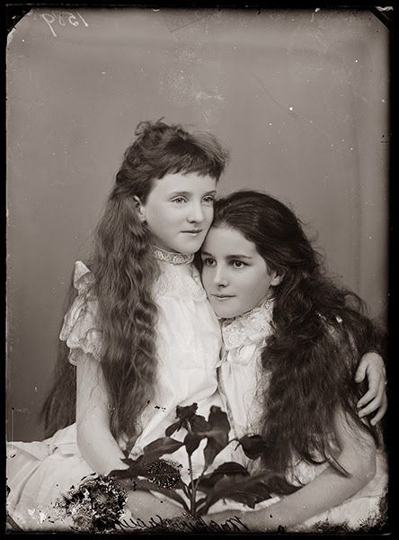Two girls, sisters ? 1890s, this is so sweet.