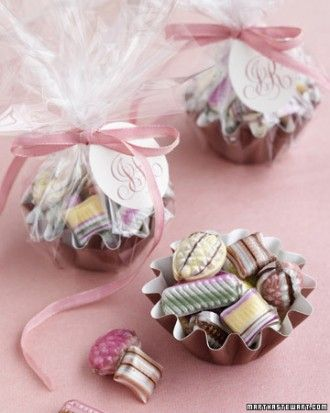 Old-Time Candy Cups  For a favor that brings out the kid in guests, turn baking cups into darling dishes brimming with old-fashioned hard candies (these have hazelnut-chocolate filling). The cups are normally used for baking single servings of brioche, so they're made of stiff paper that can hold lots of little treats. To package each favor, add candy to the cup, then wrap in cellophane. Tie closed with a ribbon threaded with a printed paper tag.