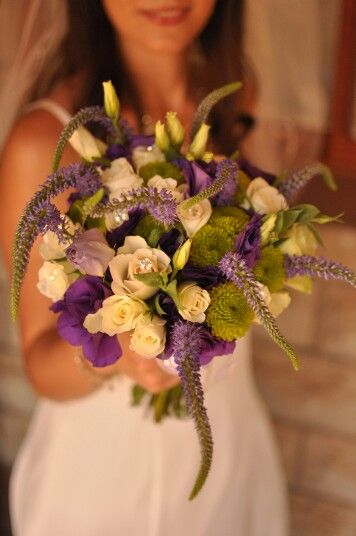 Purple, lime green and white weddings.  Roses, green buttons, purple lisianthus and veronicas.