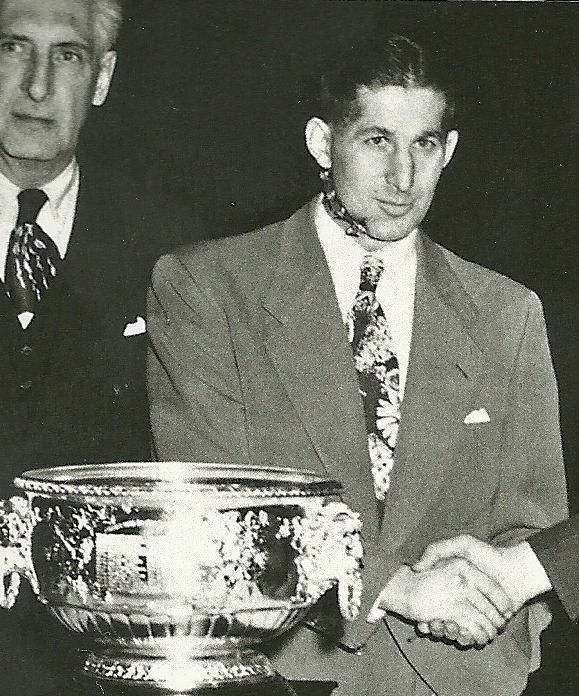 Elmer Latch accepting the Hart trophy with a wired jaw. What a class act.