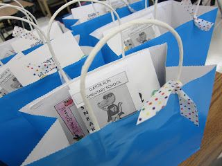 Open house gift bag with all the info parents need and if you look on the page, I like the idea of having a slideshow of last years' class playing to give parents and students an idea of what's to come for them. . .
