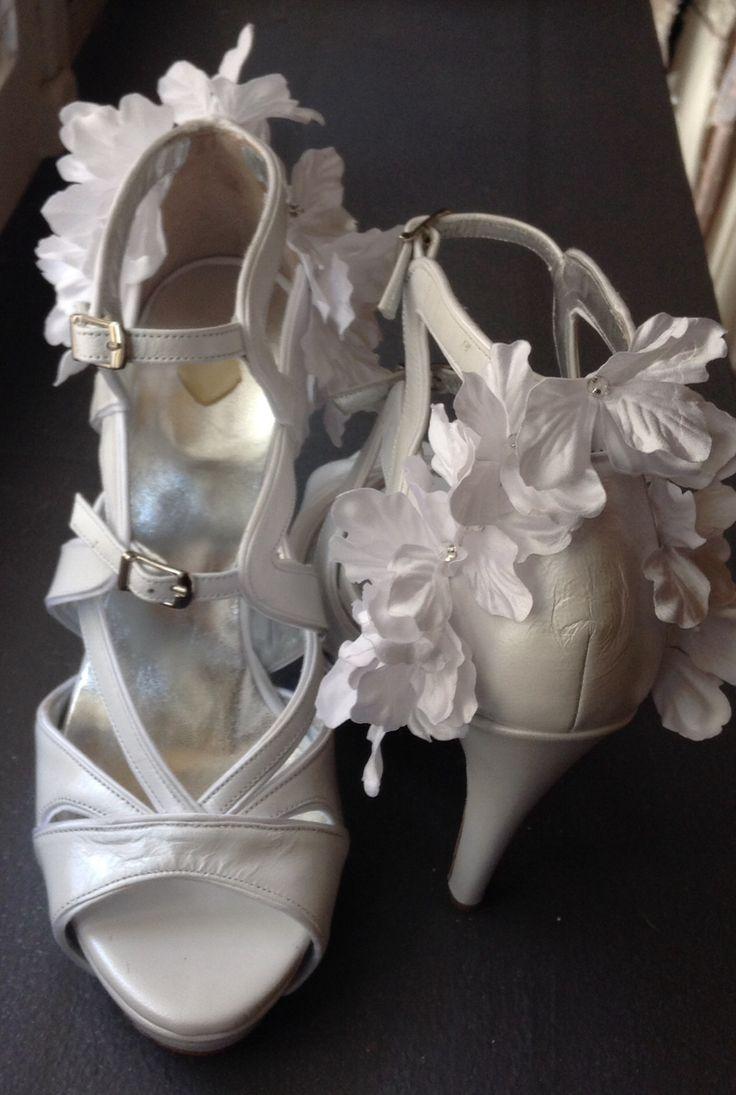 Handmade shoes by Savrani creations . White flowers shoe