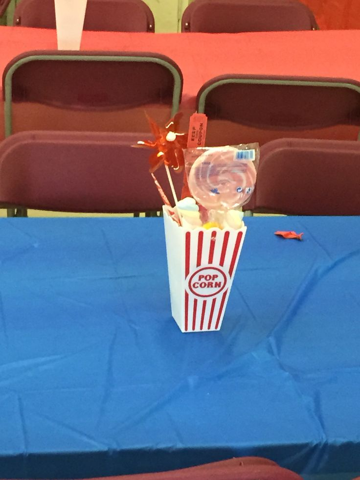 Carnival party centrepiece   Foam inside plastic popcorn container.