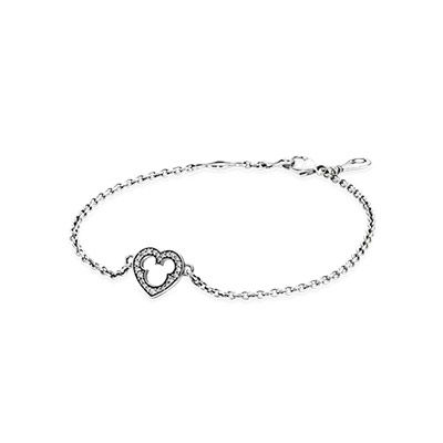 Reflecting the trend of stacking different bracelets together, this dainty chain bracelet, with the iconic Mickey Mouse silhouette cutout of a simple heart shape, will add a stylish, yet lighthearted, touch to your bracelet stack. #PANDORAlovesDisney