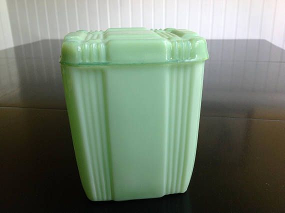 "Jadeite Glass Canister Box with Lid Crisscross Pattern  LDW:  21st Century glass canister made in China for sale at Cracker Barrel gift shops.  Mendaciously listed on Etsy as ""vintage""."