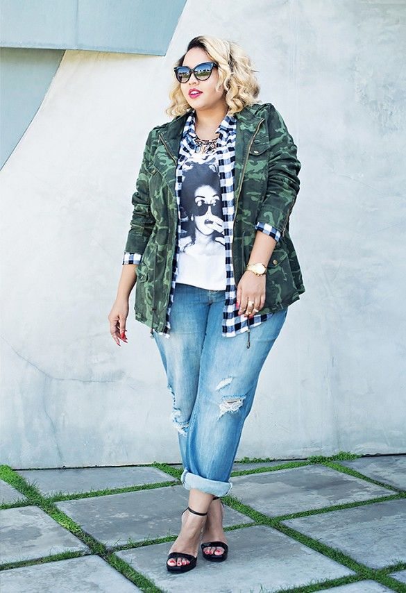 Mixed prints with a camo printed jacket layered over a plaid shirt and graphic tee.