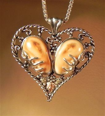 custom elk ivory jewelry makers | pair of beautiful elk ivory set in sterling silver by Ildiko Wagoner ...
