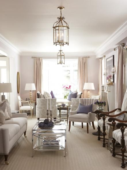 The bright living room's color palette was inspired by the lilac-hued shell balls featured on the coffee table.