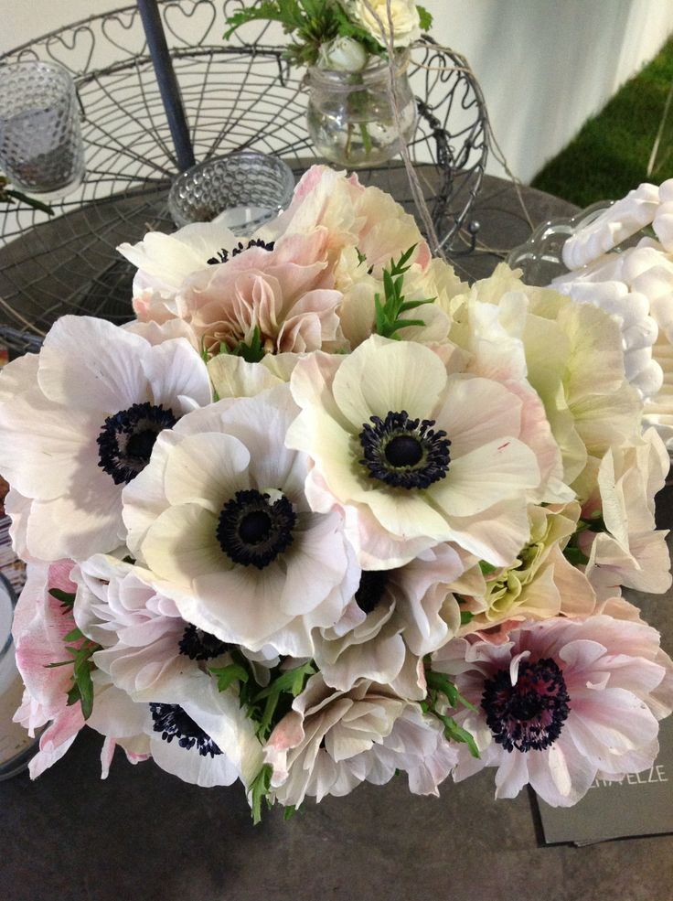 Wedding bouquet of blushing anemones.