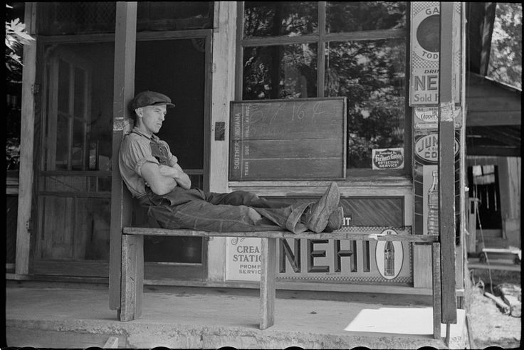 Gentleman resting outside general store in Blankenship, Martin County, Indiana, c. 1938. NEHI signs displayed out front! - historic photo