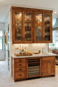 Leaded-glass diamond-paned doors for the upper cabinets on this wet bar by Crown Point Cabinetry
