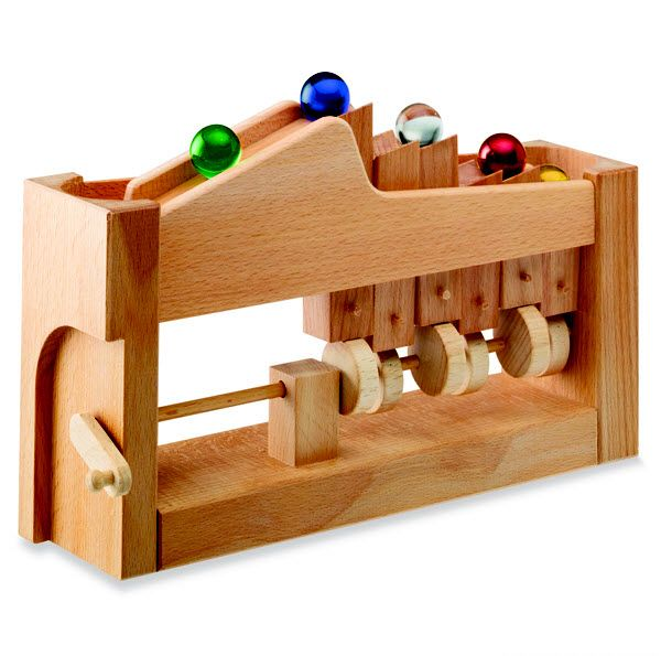 "A mechanical wooden marble track for the transport of balls or marbles. Turn the crank to propel the large glass marbles up to the top of the wooden ""escalator,"" where they roll down and advance in queue for another ride. Makes a great clacking sound as marbles bump and knock the wood! A clever heirloom […]"