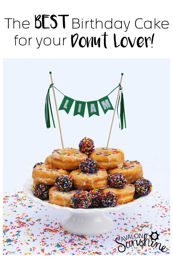 Donut cake to celebrate the donut lover's birthday!  Special birthday breakfast idea! Made with 12 donuts and a few donut holes for decoration.