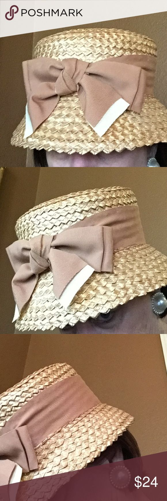 Vintage straw hat. Large grosgrain bow made to wear in front. Camel color ribbon, natural straw. In fabulous condition. No brand tag. Size medium. Shown with pearl clip earrings- not included. Vintage Accessories Hats
