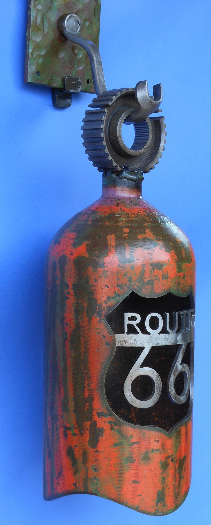 Recycled bells plasma cut. Fire brigade logo and a fire extinguisher would be awesome