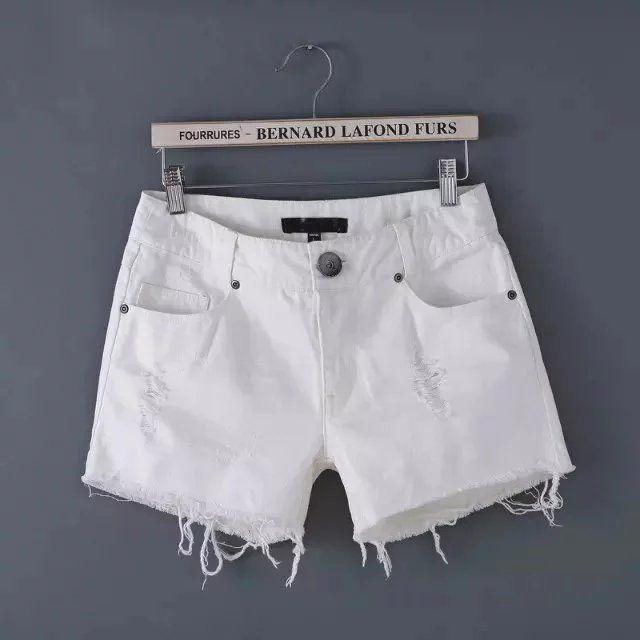 Free shipping women's fashion wild European and American style fringed white low-waist denim shorts zipper pocket hole
