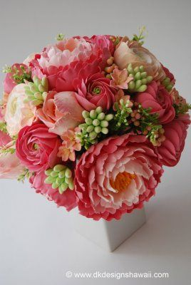 Coral pink peonies in varying shades, ranunculus in coral pink and peach tones, hyacinth in peach with pink edged petals, tuberose buds with a peach hue, and tulips. ~ @Allie Callaway