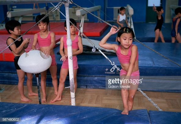 Young gymnast Zhao Chaoyue (8) has a moment to rest during her daily training at the Shishahai Sports School. This is one of the most successful training venues in China, where young gymnasts and other sports trainees live and start intensive training from the age of five. The pupils are able to visit their families at the weekend if they live in Beijing.