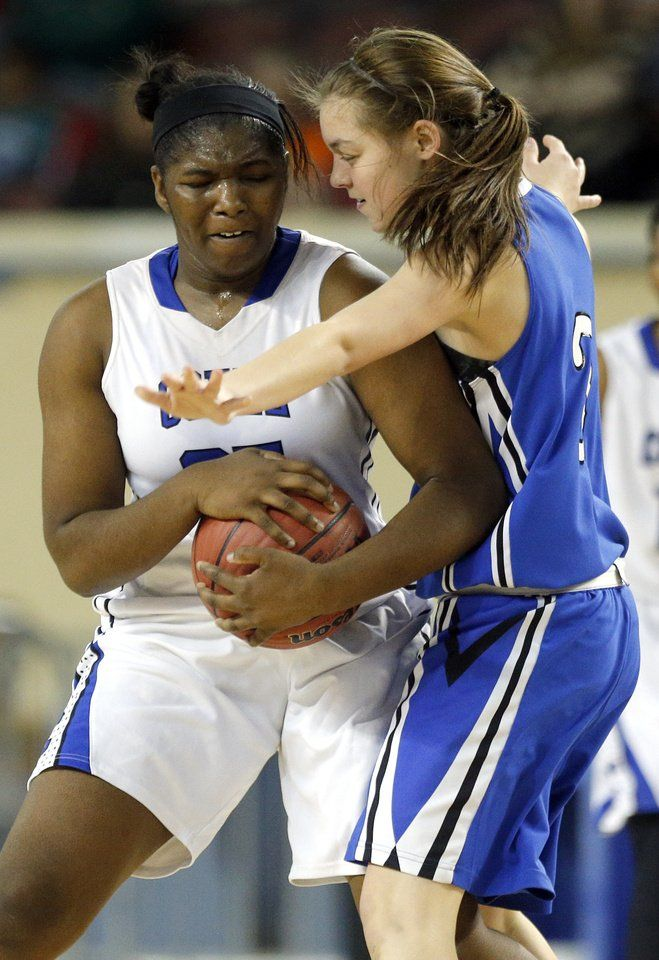 Coyle's Shilah Young protects the ball as Lomega's Kylie Biggs defends during the Class B girls high school basketball championship game between Lomega and Coyle at the Jim Norick Arena, aka The Big House, at State Fair Park in Oklahoma City, Saturday, March 7, 2015. Photo by Sarah Phipps, The Oklahoman