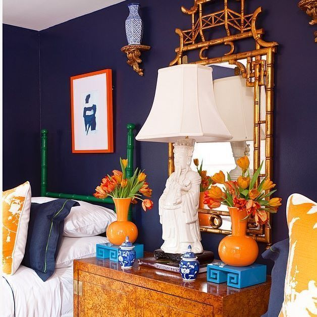 Dark Navy Blue Bedroom With Bright Orange Chinoiserie Accents