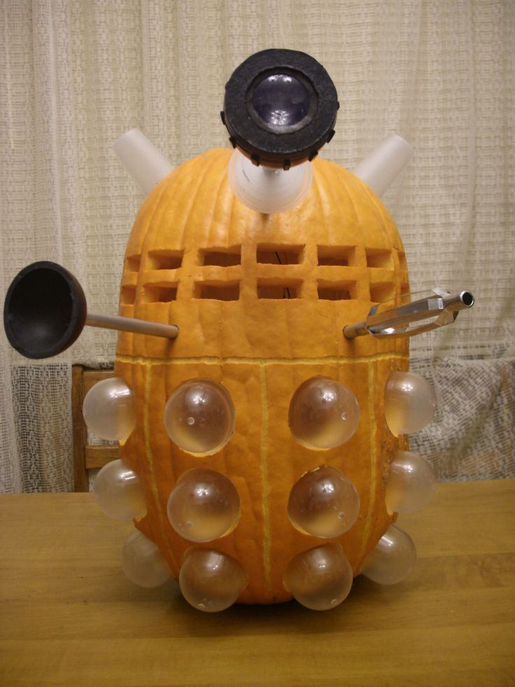 Dalek pumpkin wants to exterminate your candy!  I want to make this!