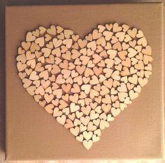 Bekijk de foto van Miesschutte met als titel Zelfgemaakt! Canvas + houten decoratie hartjes. en andere inspirerende plaatjes op Welke.nl.