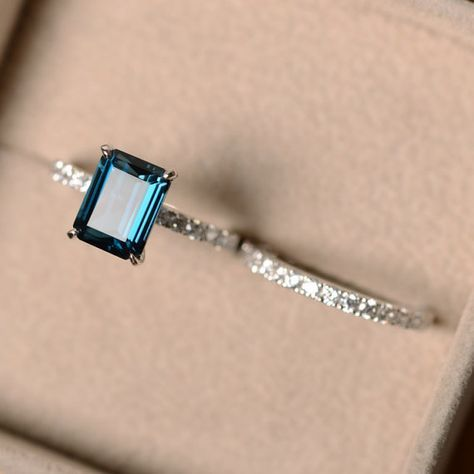 $755 -7*9mm emerald cut London blue topaz and sterling silver finished with rhodium. Customization is available. It is made by hand, and it will take about 7 days to finish the ring after your payment is completed. Main stone: London blue topaz London blue topaz weight: Approx 3.15 ct Metal type: sterling silver finished with rhodium Accent stone: cz Customization is available, I also can make it with 14k solid gold (white or yellow or rose) and diamond accent stone, just feel...