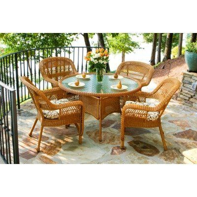 """Portside 5 Piece Dining Set Fabric Color: Café Cove Stripe, Finish: Amber by Tortuga Outdoor. $849.00. PSD-AM CAFÉ Fabric Color: Café Cove Stripe, Finish: Amber Features: -All-weather wicker.-Durable powder coated steel frames.-Unlike natural wicker, all-weather wicker is stain, water, UV, crack and split resistant.-Tempered glass 5/32"""" thick. Includes: -Set includes: 4 dining chairs and 1 dining table.-Umbrella hole and cover included.-Some assembly (table) required, ..."""