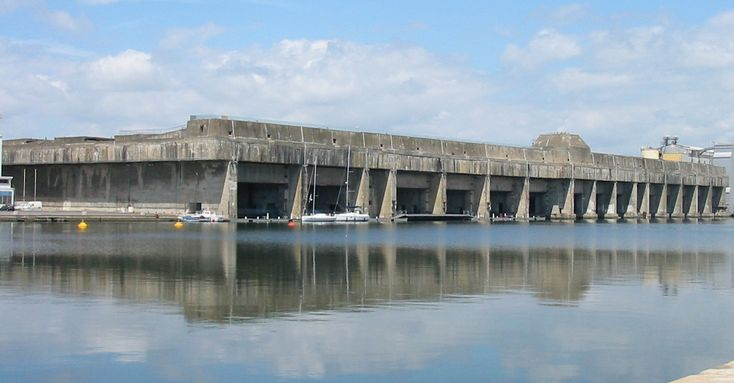 The German U-Boat pens at St Nazaire, France as they are today. The base was left untouched since demolishing it was economically unattractive. It hosts a museum and part of it is leased out to private boat owners -- who do get one super-secure berth for their vessels!