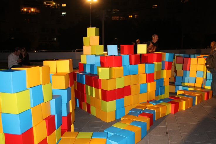 """From Tel Aviv art weekend 2012. """"dreamfields TLV"""" - A web-based game creating social structures in urban space. The interactive game had a stack of thousands of different colored cubes in the center of the game's arena, with a a 3D map that simulates the surroundings."""