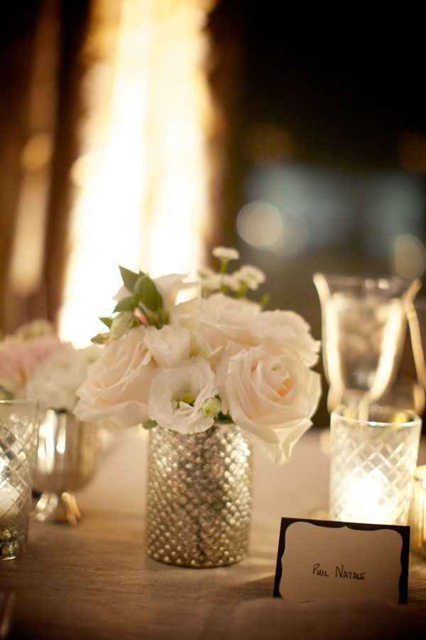 Low centerpieces with mercury glass vases & white florals.