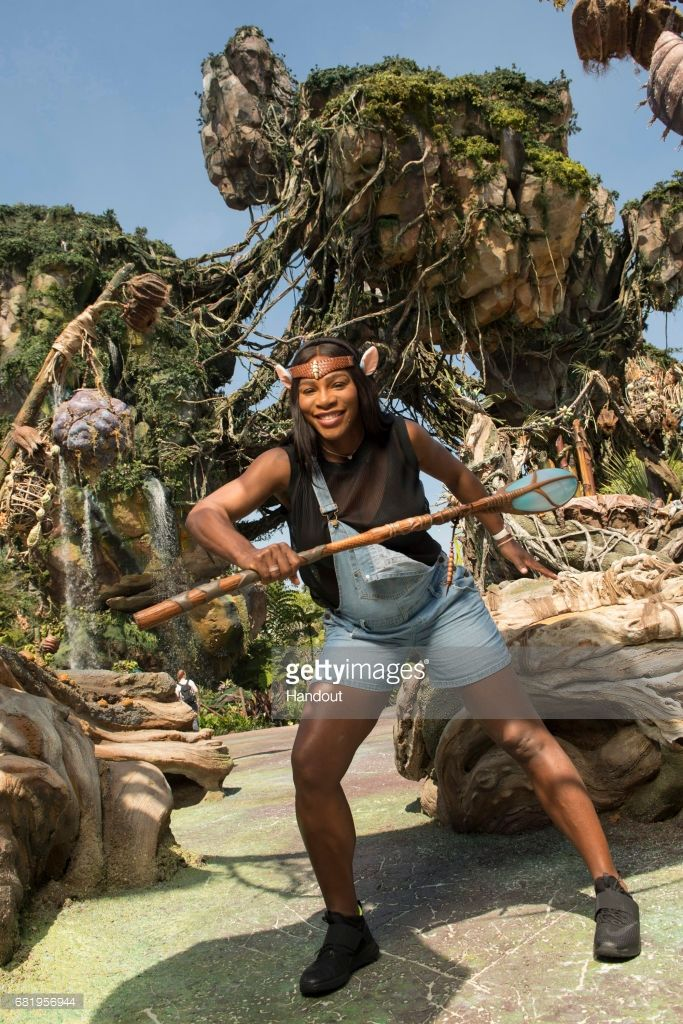 In this handout photo provided by Disney Parks, Tennis superstar Serena Williams channels her inner Na'vi during a sneak peek at Pandora - The World of Avatar at Disney's Animal Kingdom on May 9, 2017 in Lake Buena Vista, Florida. Williams, the world's No. 1-ranked player and reigning Australian Open champion, explored the newest themed land opening May 27 at Walt Disney World Resort, which immerses guests in a mystical world of massive floating mountains, bioluminescent rainforests and two…