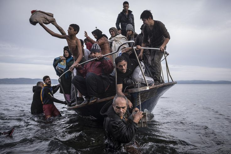 Refugees arrive by boat on the Greek island of Lesbos, November 16, 2015. By Sergey Ponomarev, World Press Photo2016 winner
