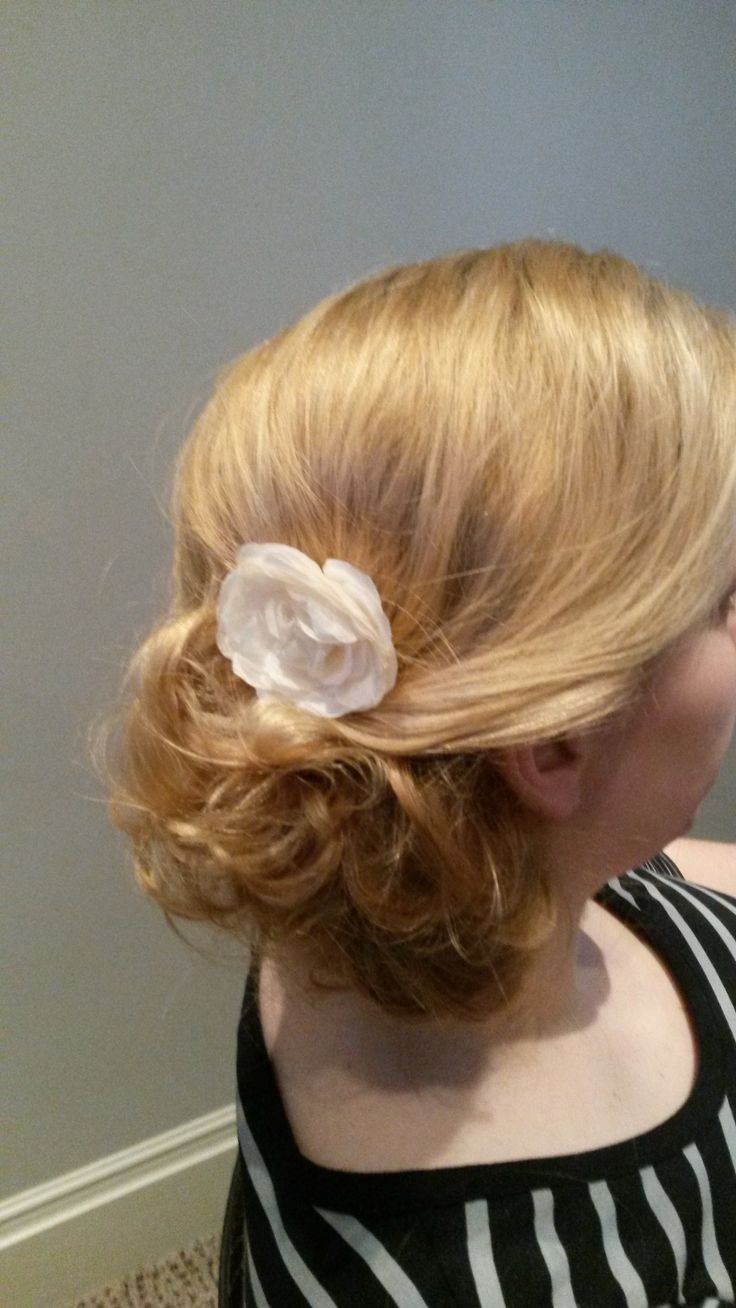 messy side bun with soft twist nd flower