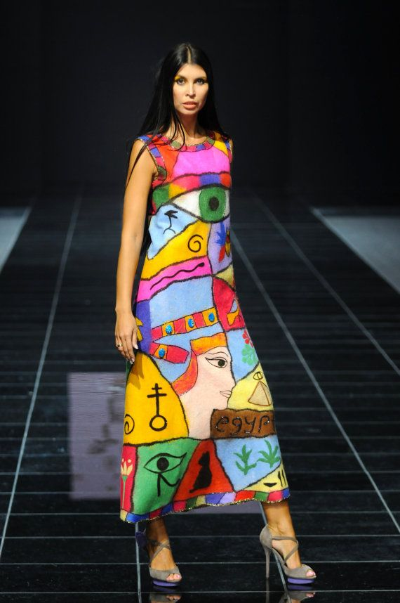 The dress is made in equipment of a wet and dry fulling, embroidered with beads on all contour border drawing. Nifertiti on a crown has natural stones of blue color. Dress very difficult. Very beautiful. Silhouette trapeze. The dress participated in two Weeks of Haute Couture - in Moscow (FROM TIME IMMEMORIAL-2011г collection) and in Spain in Madrid (SIBELES) - 2011. The dress is noted in numerous articles in the press worldwide. Exclusive. It one and the second wont be. The order for it I…