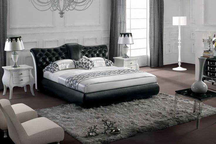 Black Tufted Queen Bed With Chrome Trim