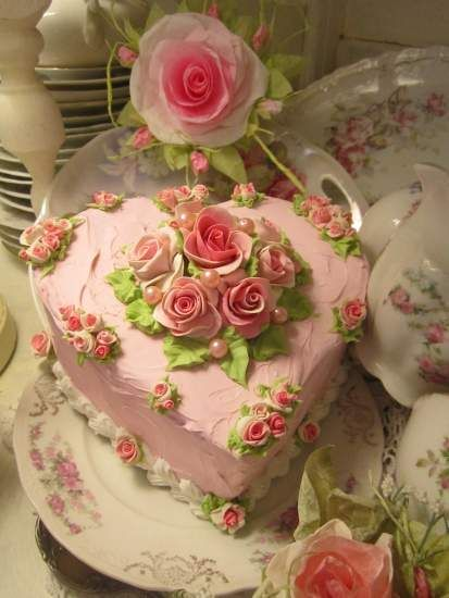 This is a Fake Cake (which would make a good Valentines decoration) but I think it provides good inspiration for decorating a real heart cake for Valentine's Day.