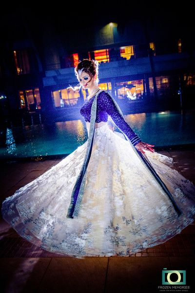 bride twirling, blue and white lehenga, blue and silver lehenga, sangeet outfit…