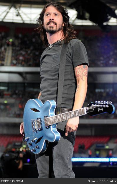 Dave Grohl - born in Warren, Ohio - American rock musician, multi-instrumentalist, and singer-songwriter, who is the lead vocalist, guitarist, primary songwriter and founder of the Foo Fighters. Prior to this, he was the drummer for the grunge band Nirvana. He is also the drummer and co-founder of Them Crooked Vultures.