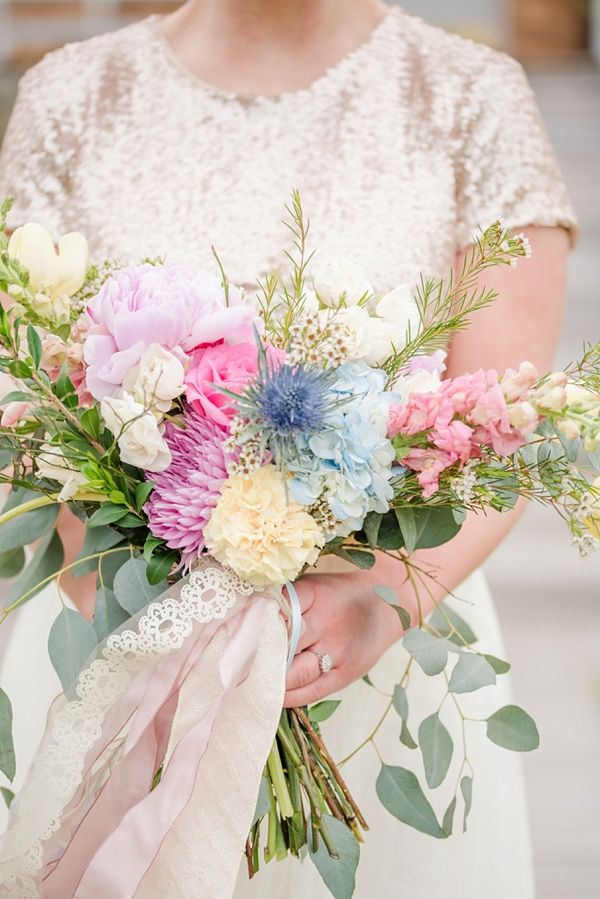 Pastel beach bridal bouquet | Michael and Laura Photography on @tidewatertulle via @aislesociety